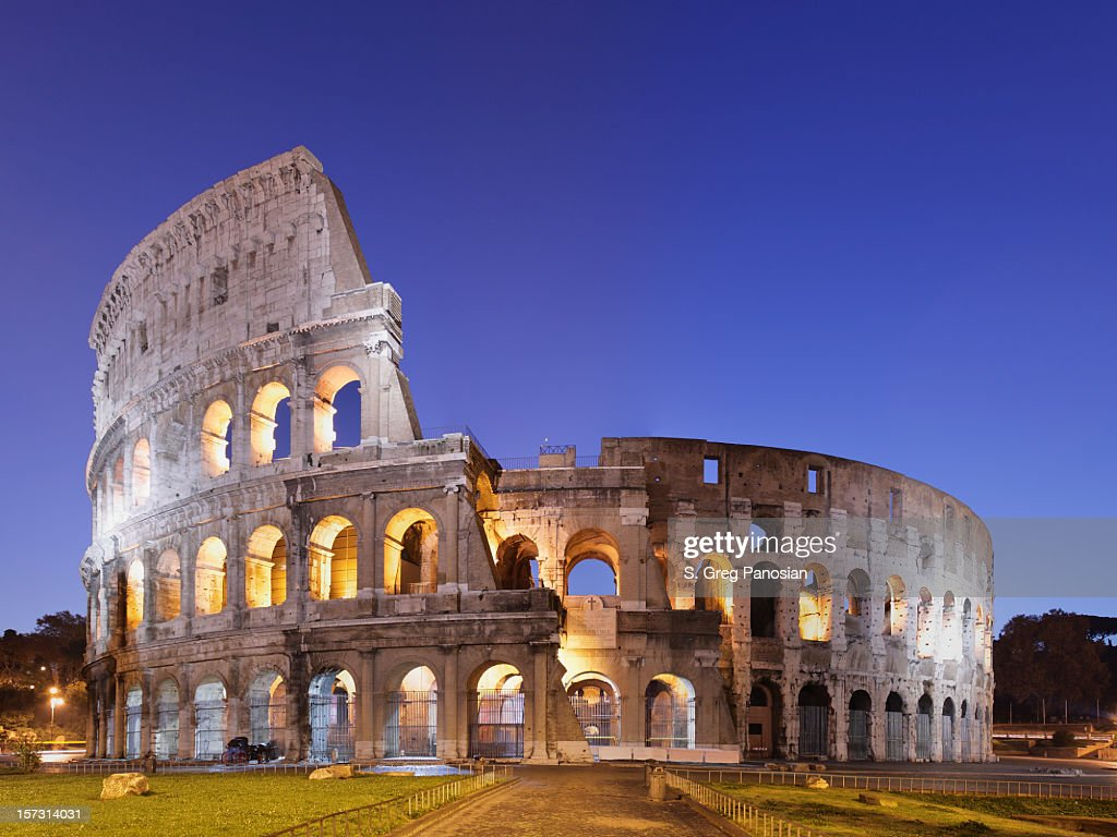Photo of the Coliseum in Rome against blue sky : Stock Photo
