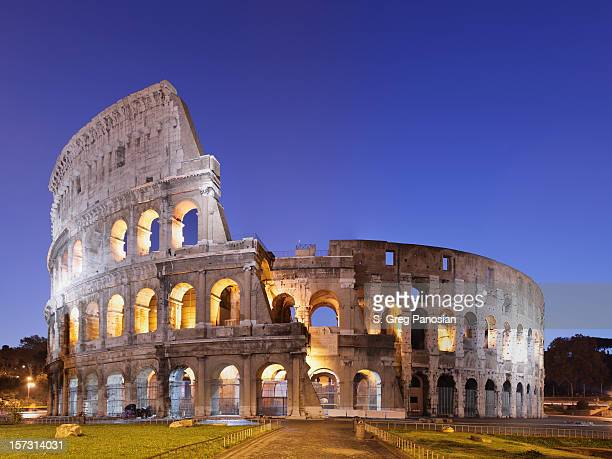 photo of the coliseum in rome against blue sky - colosseum stock pictures, royalty-free photos & images