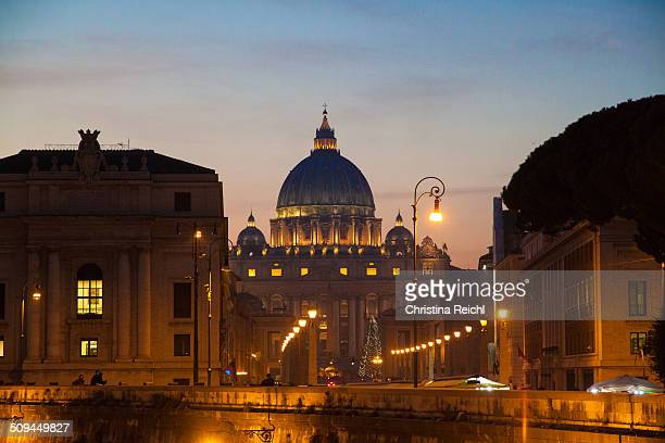 Photo of the famous Vatican City and St. Peter's Basilica attraction at dawn with the most amazing vibrant colors while the sun sets over the eternal...