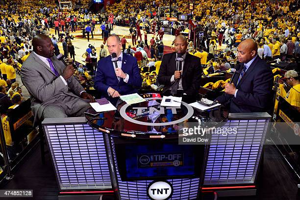 A photo of the hosts of the NBA TipOff show Shaquille O'Neal Ernie Johnson Kenny Smith and Charles Barkley at the Quicken Loans Arena during Game...
