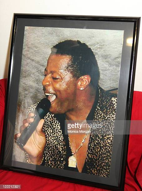 A photo of the late AliOllie Woodson is displayed on the table during Ali Woodson A Tribute to the Emperor of Soul at Bert's Warehouse Theatre on...