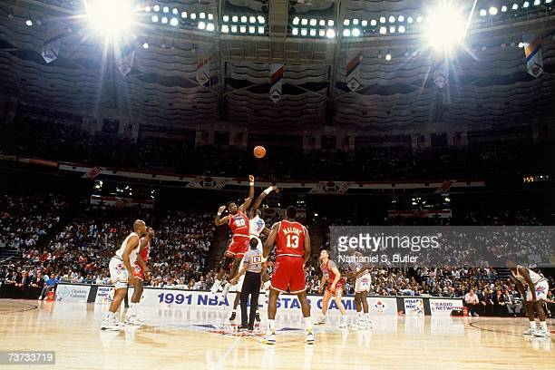 Photo of the opening tip off during the 1991 NBA AllStar game at the Charlotte Coliseum in Charlotte North Carolina NOTE TO USER User expressly...