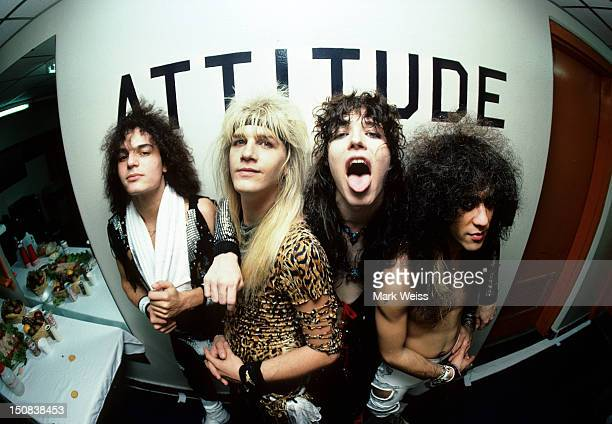 Photo of the rock band Cinderella backstage in front of a sign that says ATTITUDE