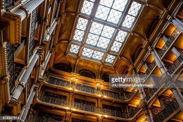 Photo of the rows of bookcases and window-paneled ceiling at the George Peabody Library of Johns Hopkins University during the Baltimore Book...