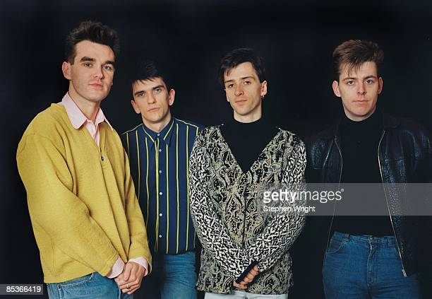 Photo of The Smiths and Andy ROURKE and Johnny MARR and Mike JOYCE and MORRISSEY LR Morrissey Mike Joyce Johnny Marr Andy Rourke posed studio group...