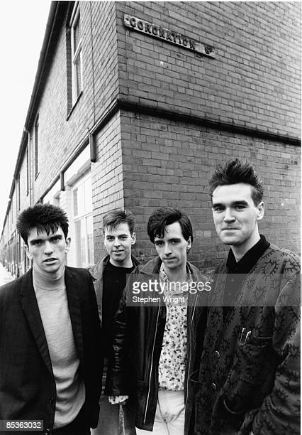 Photo of The Smiths and Mike JOYCE and Johnny MARR and Andy ROURKE and MORRISSEY LR Mike Joyce Andy Rourke Johnny Marr Morrissey posed group shot in...