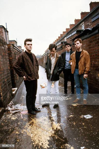 Photo of The Smiths and MORRISSEY and Mike JOYCE and Johnny MARR and Andy ROURKE LR Morrissey Johnny Marr Mike Joyce Andy Rourke posed group shot in...