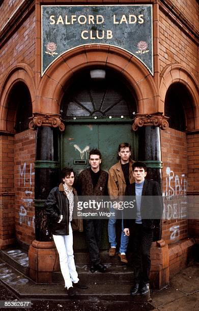 Photo of The Smiths and MORRISSEY and Mike JOYCE and Johnny MARR and Andy ROURKE LR Johnny Marr Morrissey Andy Rourke Mike Joyce posed group shot...
