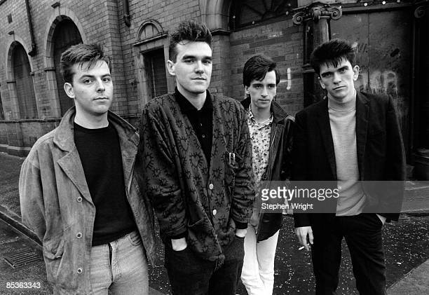 Photo of The Smiths and MORRISSEY and Mike JOYCE and Johnny MARR and Andy ROURKE LR Andy Rourke Morrissey Johnny Marr Mike Joyce posed group shot...