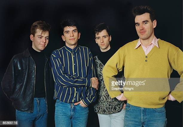 Photo of The Smiths LR Andy Rourke Mike Joyce Johnny Marr Morrissey posed studio group shot