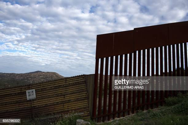 A photo of the US/Mexico border wall in Tecate northwestern of Mexico on February 14 2017 Attention Editors this image is part of an ongoing AFP...