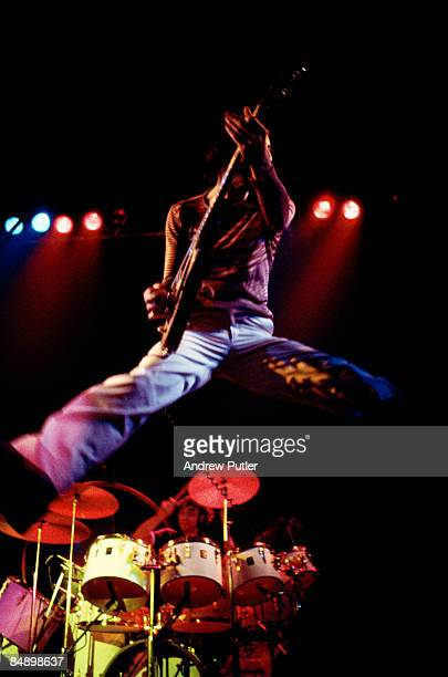 POOL Photo of The Who and Keith MOON and Pete TOWNSHEND Pete Townshend and drummer Keith Moon performing on stage jumping