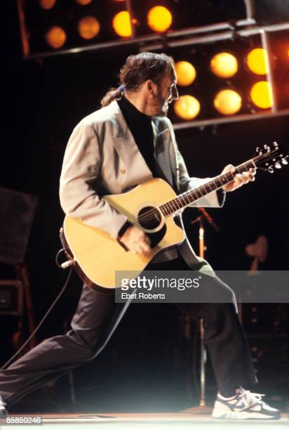 STADIUM Photo of The Who and Pete TOWNSHEND Pete Townshend performing live onstage playing Takamine acoustic guitar ponytail