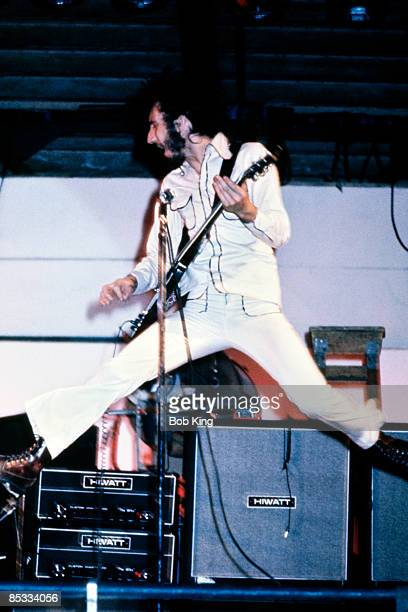 Photo of The Who and Pete TOWNSHEND Pete Townshend performing on stage jumping