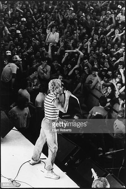 UNITED STATES SEPTEMBER 26 RICH STADIUM Photo of The Who and Roger DALTREY Roger Daltrey performing live onstage view from above stage showing crowds...