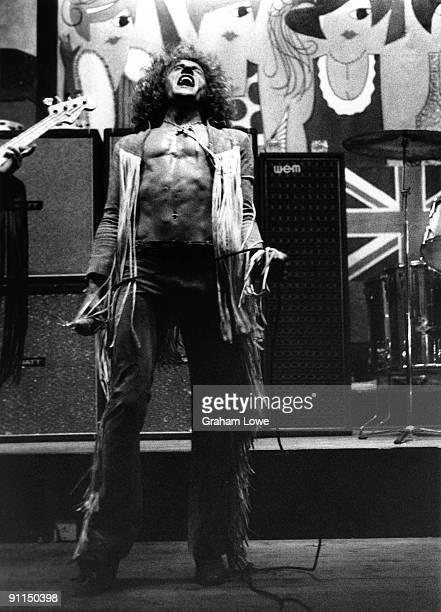 CLUB Photo of The Who and Roger DALTREY Roger Daltrey performing on stage full length leaning back