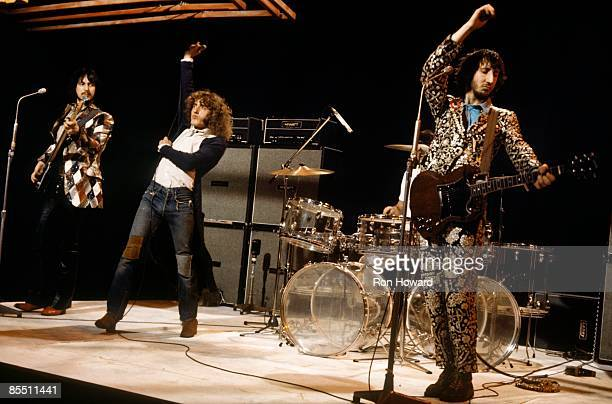 CENTRE Photo of The Who LR John Entwistle Roger Daltrey Pete Townshend performing on 'Into '71' TV show with Hiwatt amplifiers behind