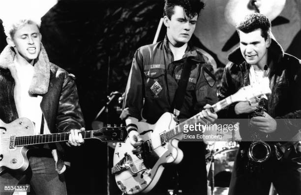 Photo of THEATRE OF HATE and Kirk BRANDON and Billy DUFFY and John LENNARD LR Kirk Brandon Billy Duffy and John Lennard performing on stage