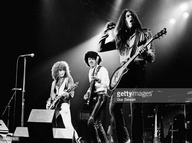 ODEON Photo of THIN LIZZY and Brian ROBERTSON and Phil LYNOTT and Scott GORHAM LR Brian Robertson Phil Lynott and Scott Gorham performing on stage