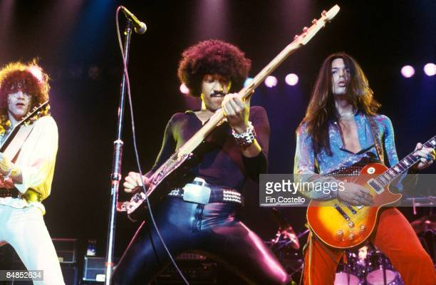 POOL Photo of THIN LIZZY and Scott GORHAM and Phil LYNOTT and Brian ROBERTSON LR Brian Robertson Phil Lynott Scott Gorham performing live onstage