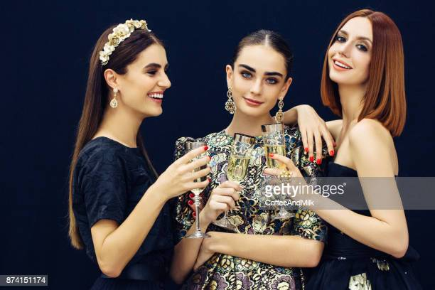 photo of three laughing girls strewn snow - ladies' night stock pictures, royalty-free photos & images