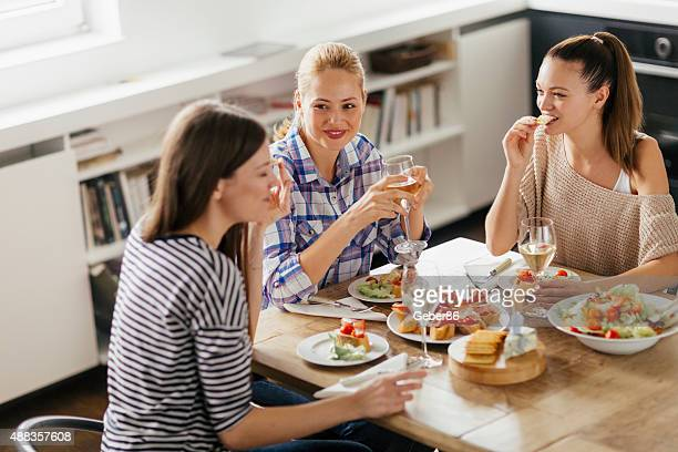 Photo of three young women enjoying time together