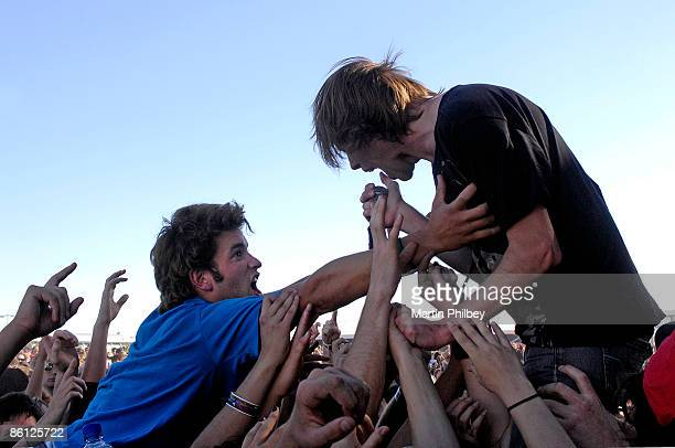 Photo of THURSDAY and Geoff RICKLY, Geoff Rickly performing on stage, audience