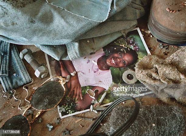 FILE A photo of Tiara Collins lays in the rubble in the abandoned home that was demolished a short time after photo was taken in Bayview Virginia on...