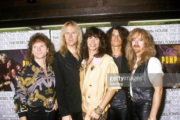 Photo of Tom HAMILTON and AEROSMITH and Brad WHITFORD and Joe PERRY and Joey KRAMER and Steven TYLER LR Joey Kramer Tom Hamilton Steven Tyler Joe...