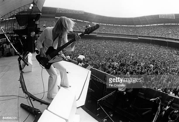 STADIUM Photo of Tom HAMILTON and AEROSMITH Tom Hamilton performing live onstage at RFK Stadium crowd playing Gibson Thunderbird bass