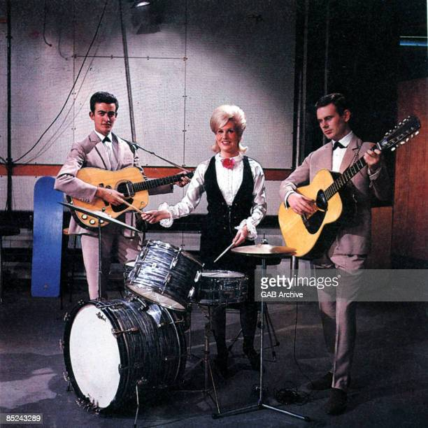 Photo of Tom SPRINGFIELD and Dusty SPRINGFIELD and Mike HURST and SPRINGFIELDS, L-R Mike Hurst, Dusty Springfield, Tom Springfield posed on the set...