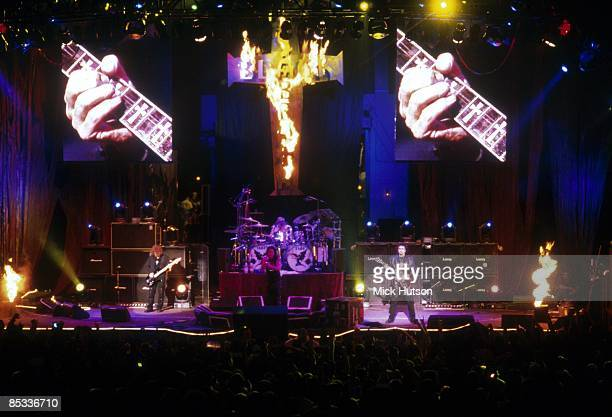 Photo of Tony IOMMI and Bill WARD and Ozzy OSBOURNE and Geezer BUTLER and BLACK SABBATH Group performing on stage Ozzfest tour fire LR Geezer Butler...