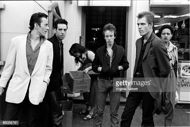 Photo of Topper HEADON and CLASH and Joe STRUMMER and Mick JONES and Paul SIMONON LR Joe Strummer Mick Jones Topper Headon Paul Simonon posed group...