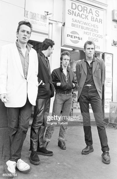 Photo of Topper HEADON and CLASH and Joe STRUMMER and Mick JONES and Paul SIMONON LR Joe Strummer Mick Jones Topper Headon Paul Simonon posed group...