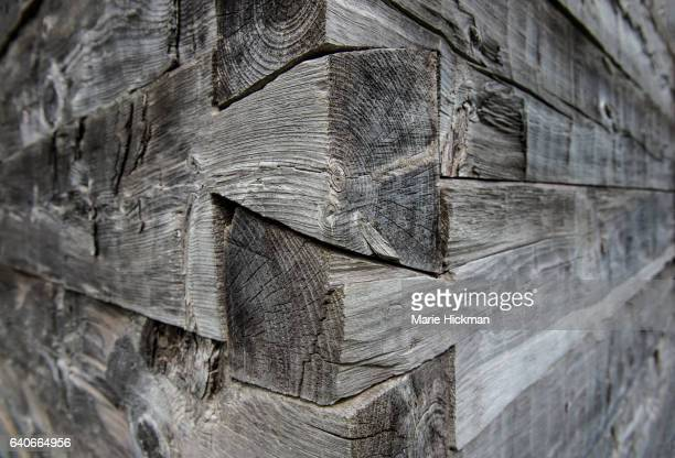 photo of tung and groove construction on a corner of a gray wooden building. - tongue and groove stock photos and pictures
