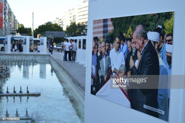 A photo of Turkish President Recep Tayyip Erdogan is seen at a photography exhibition to the 1st anniversary of Turkey's failed coup attempt in...