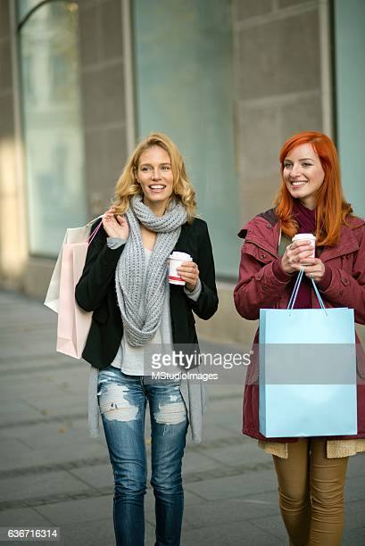 Photo of two friends shopping.