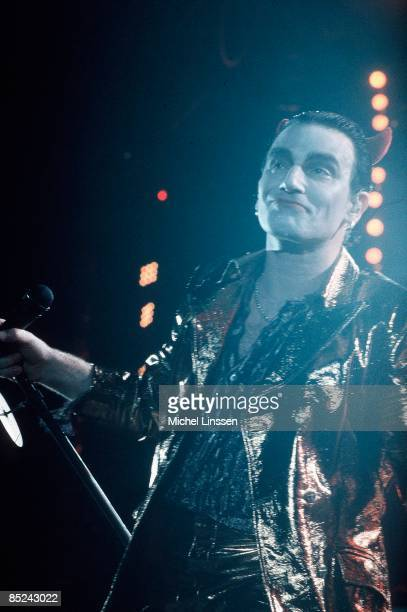 AHOY Photo of U2 and BONO Bono performing live onstage on Zoo TV tour dressed as Mister Macphisto character with devil horns