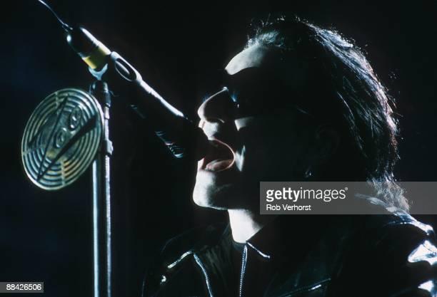 STADIUM Photo of U2 and BONO Bono performing on stage Z00 TV Zooropa Tour