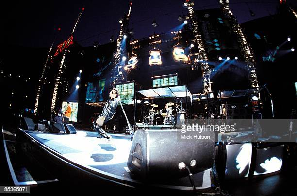 STADIUM Photo of U2 Bono performing live onstage on Zoo TV Zooropa tour showing stage set and lighting