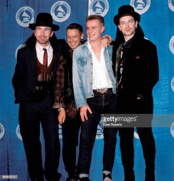 The Edge Adam Clayton Larry Mullen Jnr Bono posed group shot