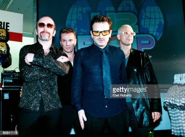 Photo of U2 LR The Edge Larry Mullen Jnr Bono Adam Clayton posed group shot at promotional show in Greenwich Village KMart shop lingerie dept to...