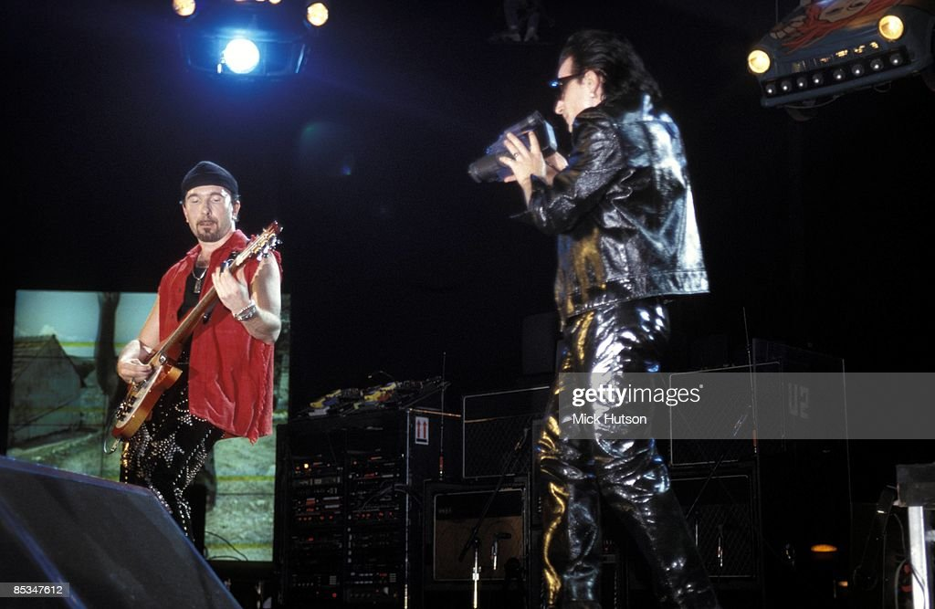 Photo of U2, The Edge and Bono performing live onstage on Zoo TV