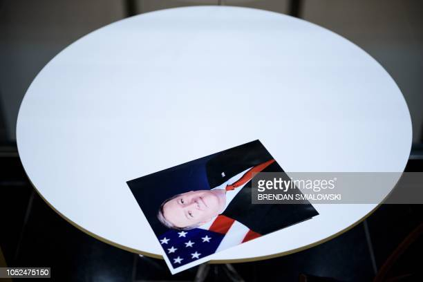 TOPSHOT A photo of US Secretary of State Mike Pompeo is seen on a table while he speaks to staff at the US embassy October 18 2018 in Panama City...