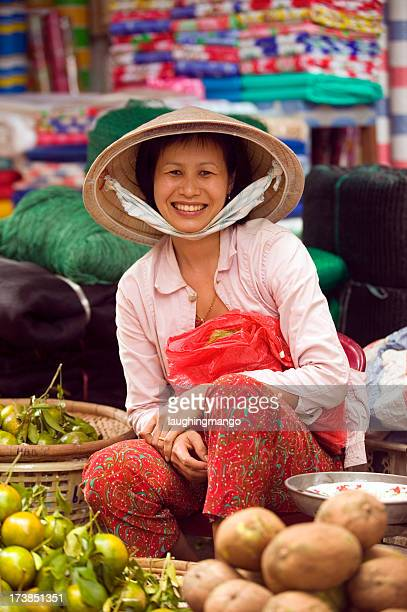 photo of vietnamese woman selling vegetables at market - traditionally vietnamese stock pictures, royalty-free photos & images
