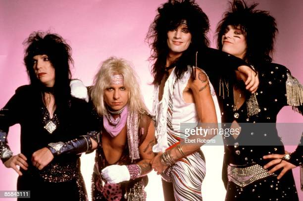 Photo of Vince NEIL and MOTLEY CRUE and Tommy LEE and Nikki SIXX and Mick MARS Posed group shot studio L R Mick Mars Vince Neil Tommy Lee Nikki Sixx