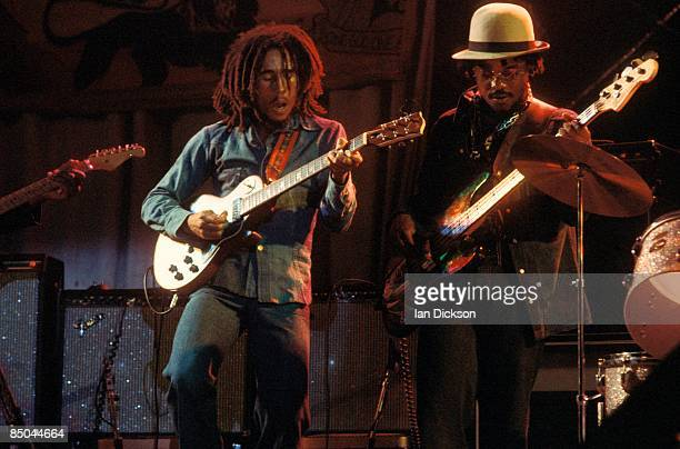 BIRMINGHAM Photo of WAILERS and Aston 'Family Man' BARRETT and Bob MARLEY Bob Marley performing live on stage at the Odeon with bass player Aston...