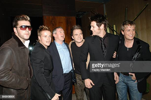 Photo of WESTLIFE and Louis WALSH with their manager Louis Walsh