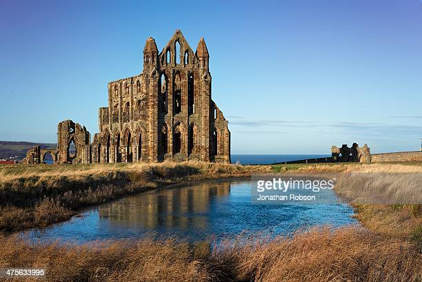 CONTENT] A photo of whitby abbey with its reflection on the water in the foreground