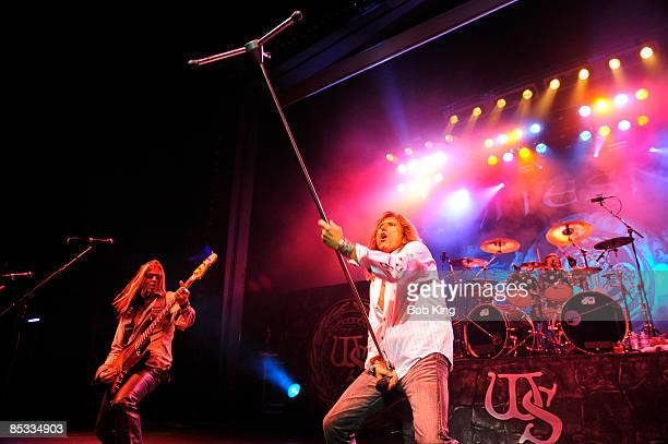 THEATRE Photo of WHITESNAKE and David COVERDALE and Uriah DUFFY Uriah Duffy and David Coverdale performing on stage microphone stand